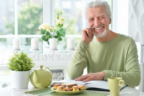 Man smiling while he gets ready to eat